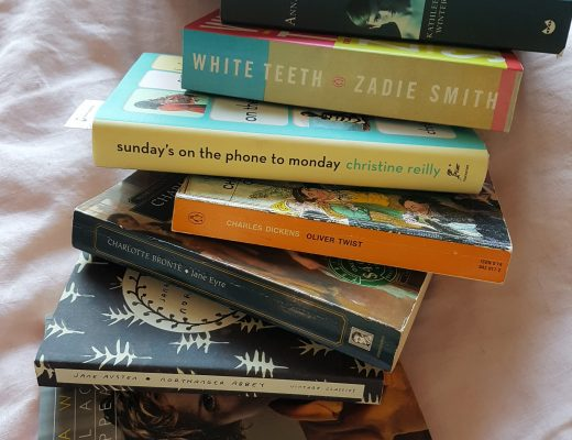 stack of books for lillytales reading resolutions